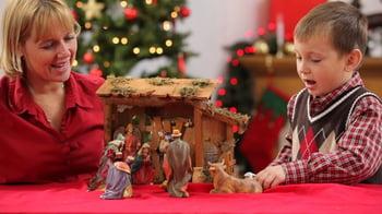 Family putting Christ into Christmas
